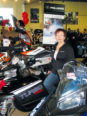 Owner of Headingley Sport Shop Jill Ruth and industry representatives tell snowmobile riders to stay on the trail.