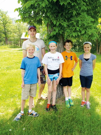 Phoenix School teacher Scott Mikkelson and (left) students Tristan, Alyssa, Colin and Teighan surveyed Headingley businesses to assess the sustainability of their operations.