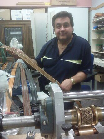 Frank Ostrowski in his belt-making shop a year after his 2009 release.
