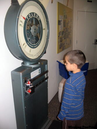 James Lockert, 5, weighs himself at Science Museum of Minnesota.