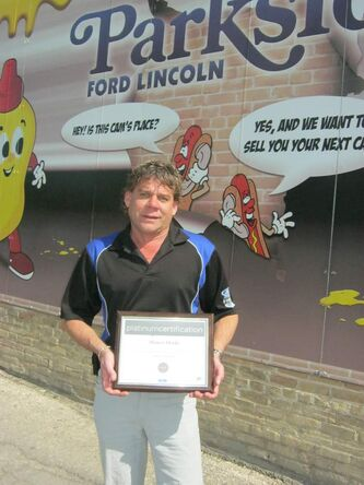Parkside Ford sales rep Shawn Henke with Summit Award plaque. Henke was top-selling Manitoba Ford sales rep and fifth in Western Canada.