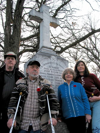 From left to right: Art Bloomfield, Larry Haag, Karen Moffatt and Carolyn McIntyre seen next to a restored cenotaph in St. Norbert Cemetery.
