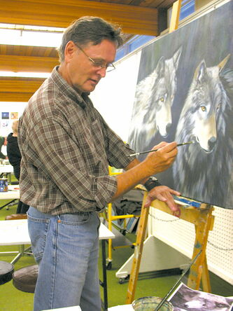 Artist Craig Johnstone, president of the board at Forum Art Centre, takes some time to brush up on his skills.