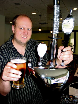 Owner of The Grove, Miles Gould, pulls a pint of his tasty new Stafford Street Ale.
