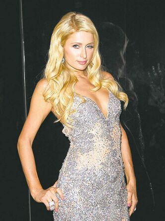Paris Hilton arrives at the launch of Marquee, The Star entertainment venue in Sydney, Australia, Saturday, March 31, 2012. (AP Photo/Rob Griffith)