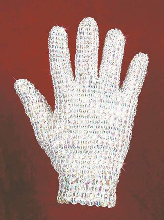 FILE- This undated file photo provided by Julien's Auctions, shows a Michael Jackson right-handed glove covered in crystals, designed by Tompkins & Bush. Costumes worn by Michael Jackson commanded hundreds of thousands of dollars at auction, and Lady Gaga was among the collectors. The auction featuring the collection of Jackson's longtime costume designers Dennis Tompkins and Michael Bush raised more than $5 million.(AP Photo/Julien's Auctions, File)