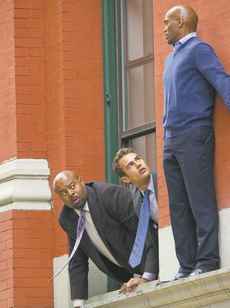 McBride (left) and James (centre) find themselves out on a ledge in Golden Boy.
