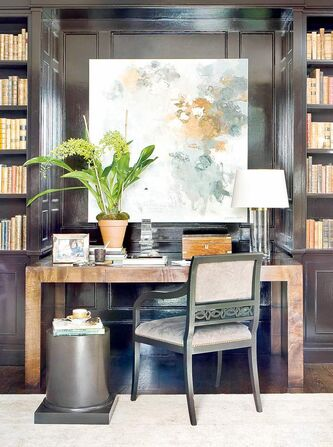 The glossy paint reflects light in this photo of a room by Robert Brown for Macrae. But really, it�s the wood Griffin writing table that warms the space.