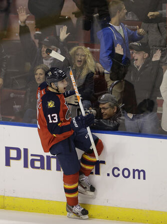 Mike Santoreilli scores the winning goal during a shootout against the Buffalo Sabres in Sunrise, Fla., March 28.