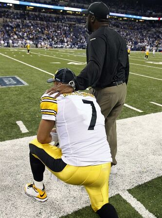Pittsburgh Steelers head coach Mike Tomlin, right, stands by quarterback Ben Roethlisberger (7) during the fourth quarter of an NFL football game against the Indianapolis Colts, Sunday, Sept. 25, 2011, in Indianapolis. Pittsburgh won 23-20. (AP Photo/Michael Conroy)