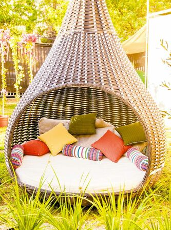 Shade-providing furniture can make the backyard a place  you might never want to leave and provides a bit of privacy.