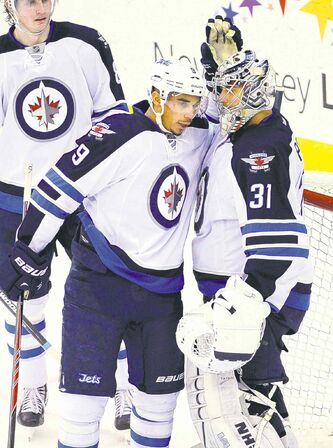 Jets' Ondrej Pavelec (31) and Evander Kane celebrate after beating the Devils in Newark, N.J., Monday.