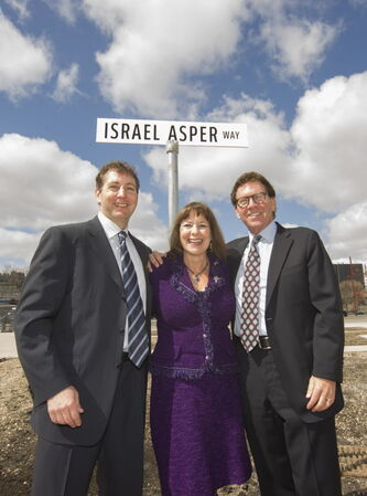 (L-R) Leonard, Gail, and David Asper pose for a photo following a ceremony to change Waterfront Dr to Israel Asper Way in front of the Canadian Museum for Human Rights.