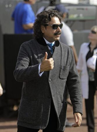 Jacksonville Jaguars' new owner Shahid Khan gives the thumbs up to fans as he walks along the field prior to an NFL football game against the Indianapolis Colts, Sunday, Jan. 1, 2012, in Jacksonville, Fla. (AP Photo/John Raoux)
