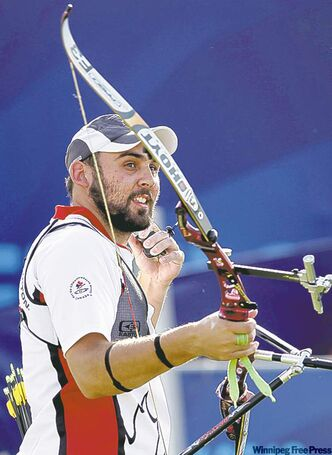 Manitoba's Jay Lyon follows a shot en route to silver in the men's individual recurve event during the Commonwealth Games at the Yamuna Sports Complex in New Delhi on Sunday.