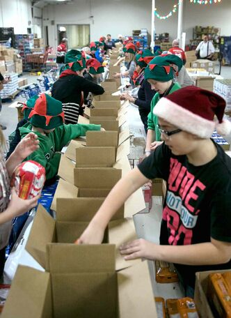 Oakenwald Elementary School students packed around 500 food hampers at Cheer Board HQ on Friday for distribution to families in need.
