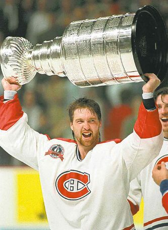 Goaltender Patrick Roy hoists the Stanley Cup  in this June, 1993 photo after the Montreal Canadiens beat the Los Angeles Kings to win the Stanley Cup.