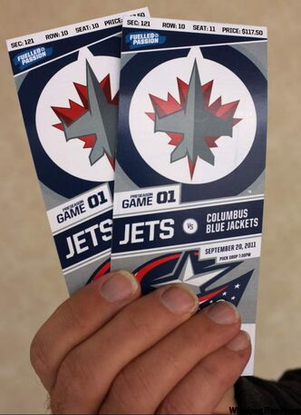 A woman has been charged after allegedly defrauding people who wanted to buy Winnipeg Jets tickets.