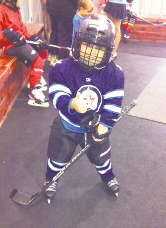 Five-year-old Sully Rossnagel hasn't let a rare disease keep him off the ice.