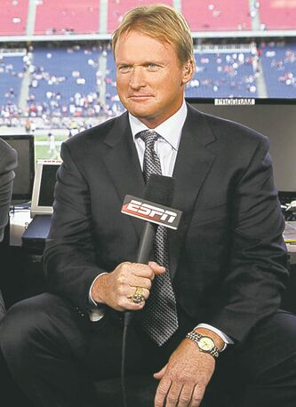 FILE - This Sept. 14, 2009, file photo, shows ESPN broadcaster Jon Gruden before an NFL football game between the New England Patriots and the Buffalo Bills in Foxborough, Mass.  Gruden is saying again that he's committed to staying at ESPN. Gruden says he's