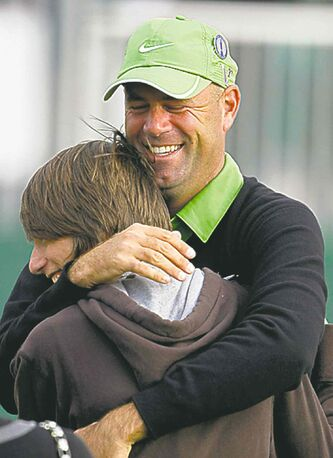 Stewart Cink hugs son Connor after winning the British Open in 2009.