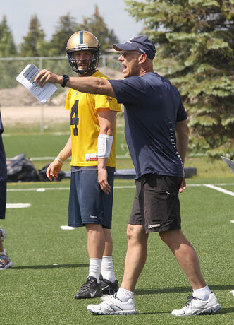 Offensive Coordinator Gary Crowton yells instructions as Bombers starting quarterback Buck Pierce listens in during practice today. The website bodog.ca listed Pierce as the longest shot on the board at 20-1 to lead the CFL in passing yards in 2013.