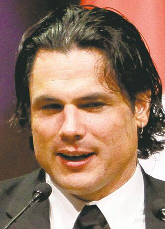 Senator Patrick Brazeau accepts the Bad Sport Award at the National Press Gallery Dinner Saturday in Gatineau, Quebec, Saturday November 3, 2012. THE CANADIAN PRESS/Fred Chartrand