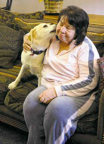 Rosie cheers up Helen Amarant,  who was visiting a family member  at the California hospice.