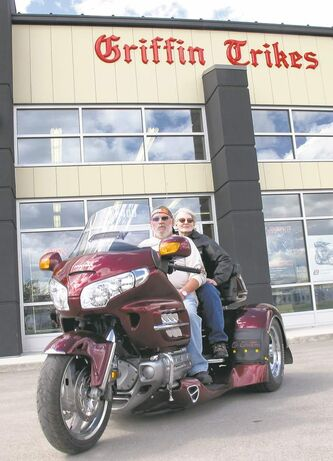 Ray and Judith Vasas on their cherry-black Honda Gold Wing trike.