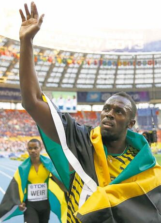 Always the showman, Jamaican runner Usain Bolt celebrates winning gold  in the 200-metre final Saturday in Moscow.