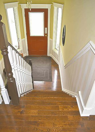 The entire upstairs of this bi-level home has been covered with T&G oak including the treads of the staircase.