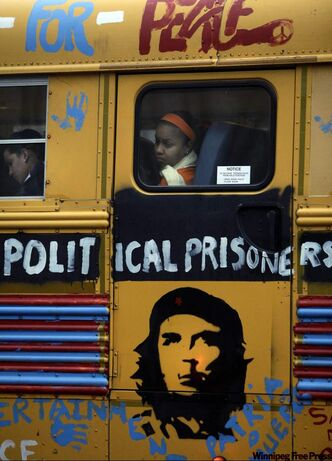 "People travel on a bus with an image of Argentinean born Cuban revolution leader Ernesto ""Che"" Guevara in Havana."