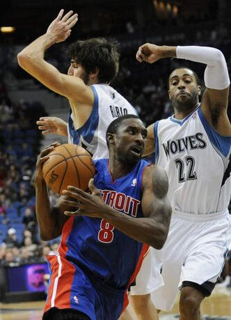 Detroit Pistons' Ben Gordon drives around Minnesota Timberwolves players during game on Jan. 18, 2012 in Minneapolis.