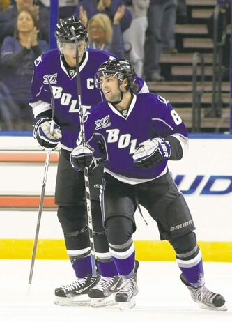 Tampa Bay's Cory Conacher (right) celebrates with teammate Vincent Lecavalier after scoring in the first period.
