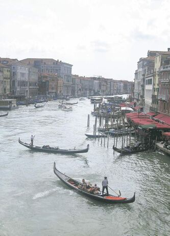 Gondolas jockey for position on the Grande Canale in the heart of Venice, Italy.