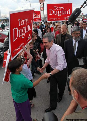 Liberal Leader Michael Ignatieff greets young supporters at a rally in Winnipeg on Tuesday evening. It's likely his last visit to Manitoba during the election campaign. He hopes to boost his party's standings after Monday's vote. They had two of Manitoba's 14 seats when Parliament was dissolved last month.