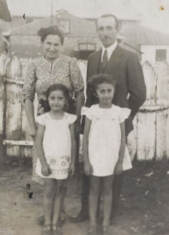 <p>SUPPLIED</p><p>Carmela, her sister Betty and her parents, Caroline and Leon, in Poland in 1937.</p>