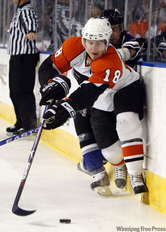 Flyers' captain Mike Richards (18) hopes to get invited to the Canadian Olympic men's hockey team's summer camp.