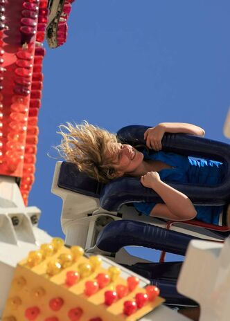 Reporter Elizabeth Fraser hangs on tight on a breezy ride aboard the Fireball at the Ex on Tuesday.