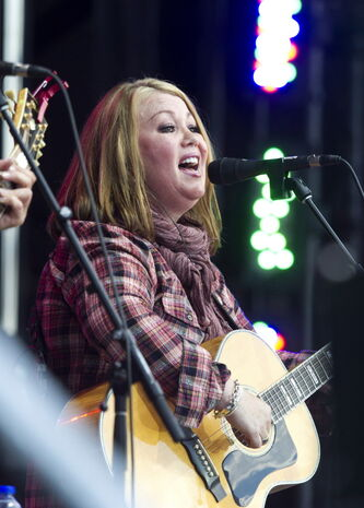 Jann Arden performs during the Alberta Flood Aid concert in Calgary, Alberta on Aug. 15, 2013.