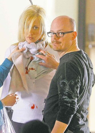 TREVOR HAGAN / WINNIPEG FREE PRESS - Makeup artist, Doug Morrow, right, contains artificial blood on the neck of Samatha Kendrick during filming of Wrong Turn 4. The horror flick is being shot at the former Brandon Mental Health Institute in Brandon, Manitoba. 11-03-07