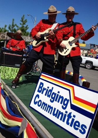 RCMP officers Const. Doug Sokoloski on the guitar, centre, Const. Forrest Anderson on the bass, right, and Const. Jason Fichtner on drums participate in a parade in Pincher Creek, Alta., in the summer of 2012 in this undated handout photo. THE CANADIAN PRESS/HO