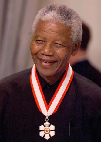 South African President Nelson Mandela smiles after recieving an honorary Investiture into the Order of Canada at a ceremony in Ottawa in 1998. It was the first time a foreign Head of State had recieved the award.