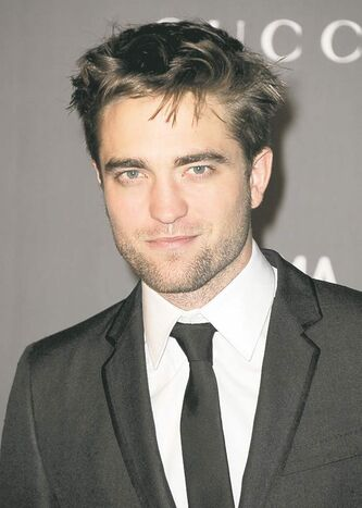 Robert Pattinson arrives at the 2012 ART + FILM GALA hosted by LACMA on Saturday, Oct. 27, 2012, in Los Angeles. (Photo by Jordan Strauss/Invision/AP)