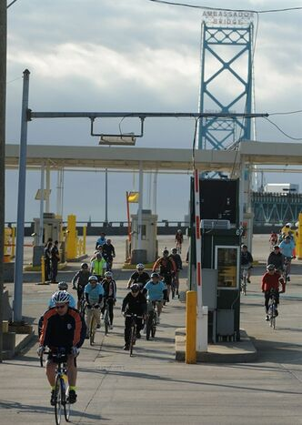 One hundred and fifty cyclists pedaled their way across the Ambassador Bridge and throughout southwest Detroit, Sunday Oct. 13, 2013 during Tour de Troit's