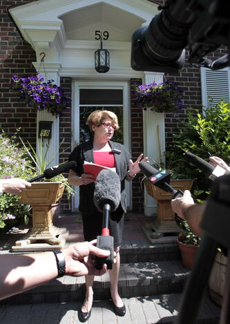 Mayoral candidate Judy Wasylycia-Leis holds a news conference in front of her home Thursday morning, in which she promised to 'clean house' at city hall.