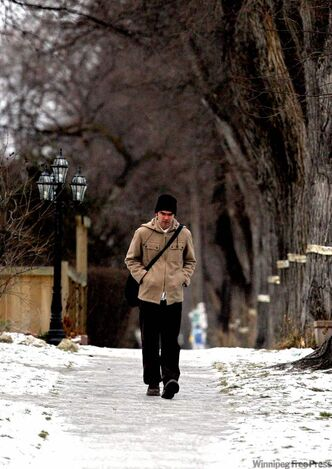 A Wolseley resident walks down an icy sidewalk on Ethelbert Street.
