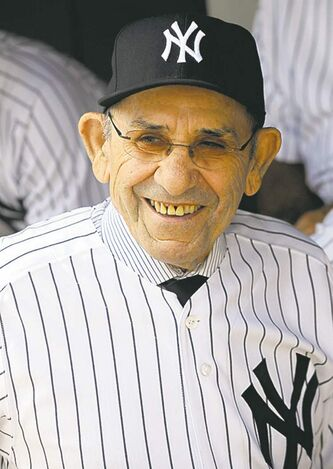 Former New York Yankees catcher Yogi Berra smiles in the dugout during Old Timers' Day events Sunday, June 26, 2011, at Yankee Stadium in New York. (AP Photo/Bill Kostroun)