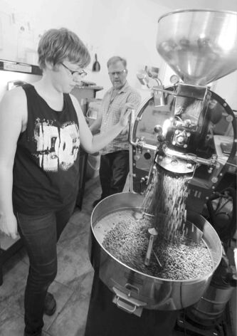 Owner Derryl Reid and daughter, Alix, supervise the roasting.