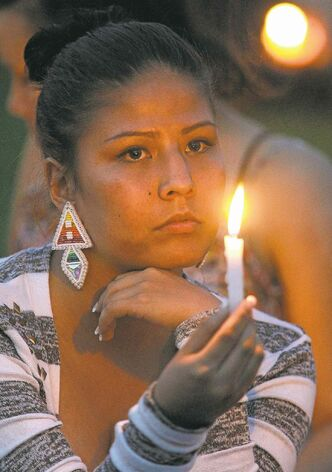 Mourners attend a vigil Tuesday.